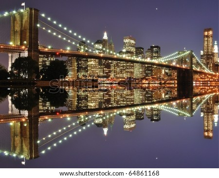 The Lower Manhattan Skyline and Brooklyn Bridge with serious reflections in New York City. - stock photo
