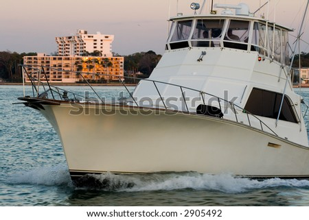 The luxury yacht is sailing in a bay. - stock photo