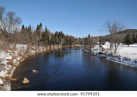 The Magalloway River in Lincoln Plantation, Maine, on a cold winter day - stock photo