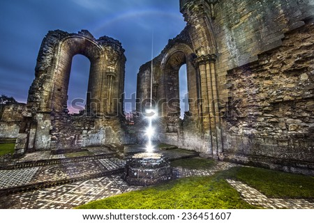 The magical ancient spell of light has been cast near the ruins - stock photo
