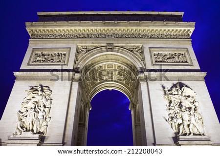 The magnificent Arc de Triomphe in Paris, France. - stock photo