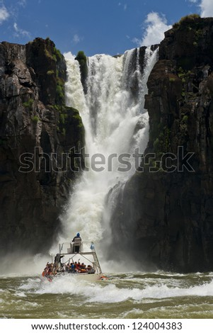 the magnificent garganta del diablo at the iguazu falls, one of the seven natural wonders of the world, between Argentina and Brazil - stock photo