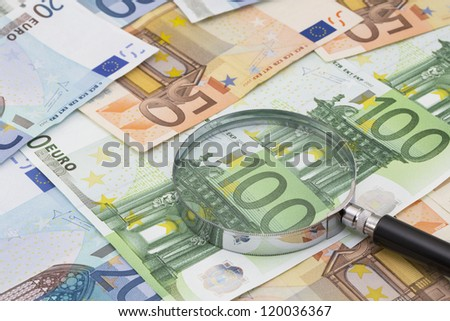 The magnifying glass on Euro notes - stock photo