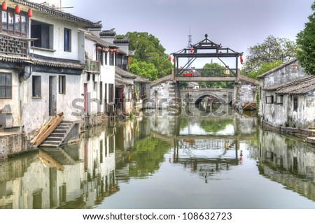 """The main bridge of Tongli, China - Tongli, or Tong-Li is a town in Wujiang county, on the outskirts of Suzhou. It is known for a system of canals, it has been given the nickname """"Venice of the East"""". - stock photo"""