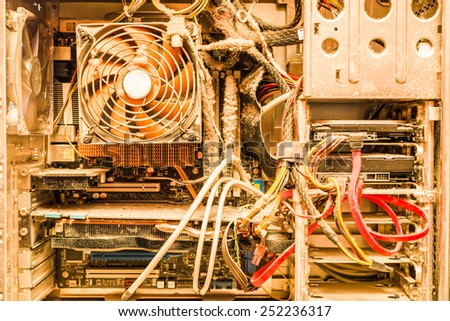 The main components of the outdated, dusty and non-working computer. In yellow tones - stock photo