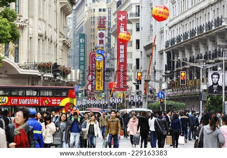 The main street in Shanghai - Nanjing Road. China. Editorial. 10.11.2013 - stock photo