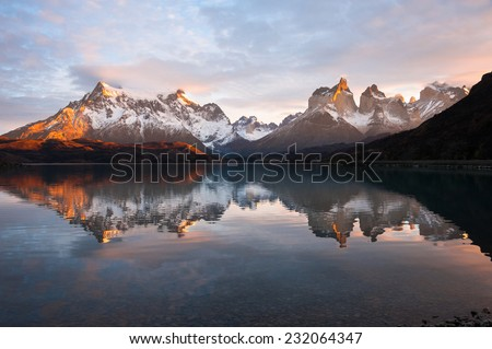 The Majestic Cuernos del Paine (Horns of Paine) reflect in lake (lago) Pehoe, Torres del Paine National Park, Patagonia, Chile - stock photo