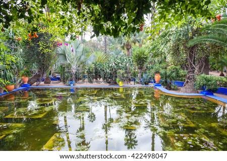 The Majorelle Garden is a botanical garden and artist's landscape garden in Marrakech, Morocco. - stock photo