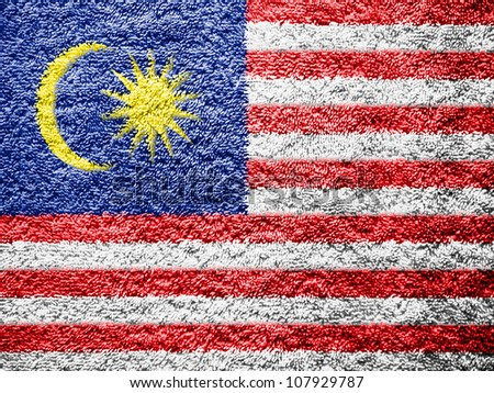The Malaysia flag painted on towel surface - stock photo