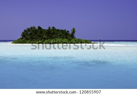 The Maldives are located south of India's Lakshadweep islands, and about seven hundred kilometers south-west of Sri Lanka. The twenty-six atolls encompass a territory featuring 1,192 islets. - stock photo