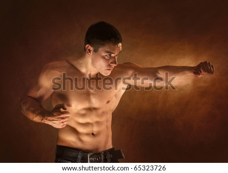 The male body on black - stock photo