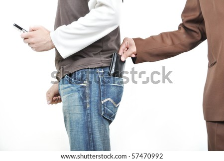 The male hand pulls out a purse from a pocket of the man. - stock photo