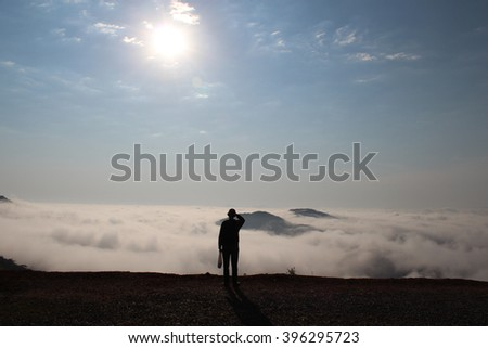 The Man Above The Sea of Clouds - stock photo