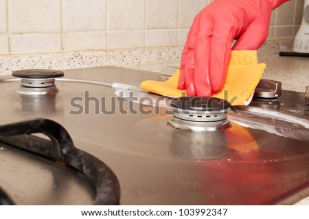 The man cleaning gas stove - stock photo