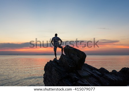 The man costs on a chip and the beautiful landscape, the island Samui, Thailand admires a decline, - stock photo