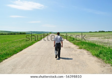 The man goes away on the road - stock photo
