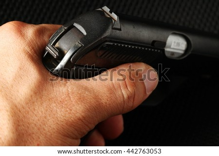 The man hand in holding action of old and dirty automatic gun represent the weapon abstract concept related idea. - stock photo
