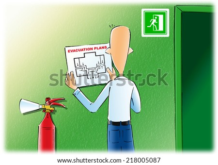 The man hangs up fire safety on the wall with a safety emergency sign and fire extinguisher. Evacuation plans & fire extinguishe. - stock photo