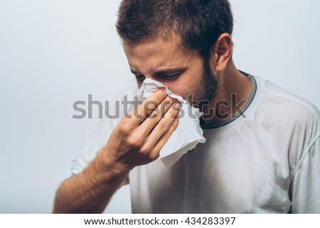 the man has a runny nose - stock photo