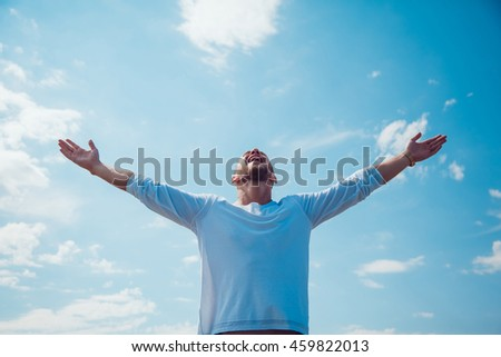 The man held out his hands to the sky. Freedom. - stock photo