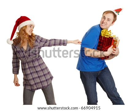 The man hides all Christmas gifts from the woman isolated on a white background - stock photo