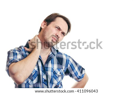 The man in a shirt pulled a neck and felt the severe pain. Holding a hand a neck rubs screwing up the face - stock photo