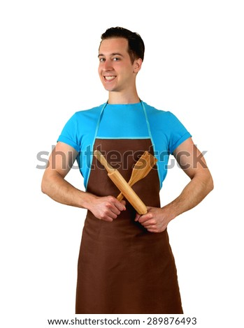 The man in the kitchen wearing an apron holding a rolling pin. isolated - stock photo