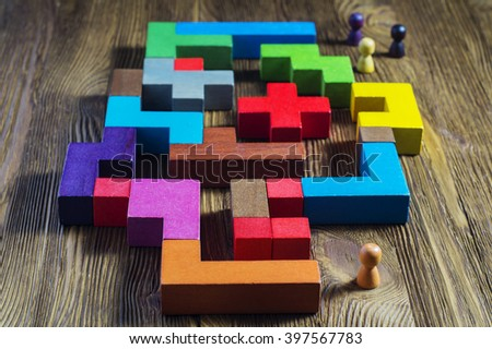 The man in the maze. The concept of a business strategy, analytics, search for solutions, the search output. Labyrinth of colorful wooden blocks, tetris. - stock photo