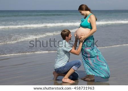 Kneeling Down While Pregnant Kneeling Stock P...