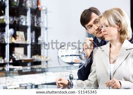 The man puts on to the wife a jeweller necklace - stock photo