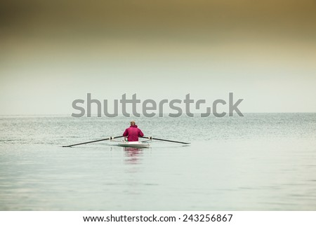 The man rower in a boat - stock photo