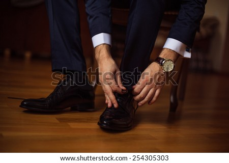 The man wears shoes. - stock photo
