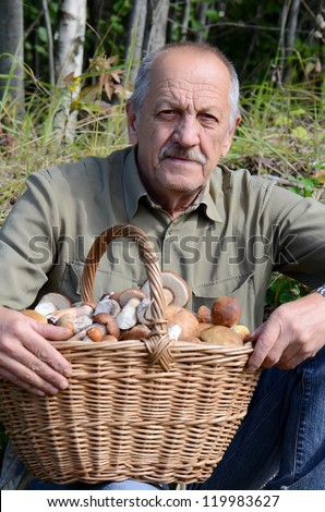 The man with a basket of mushrooms - stock photo