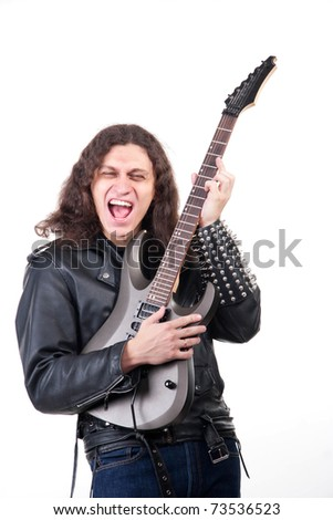 The man with long hair is playing electric guitar and singing. Isolated on white - stock photo