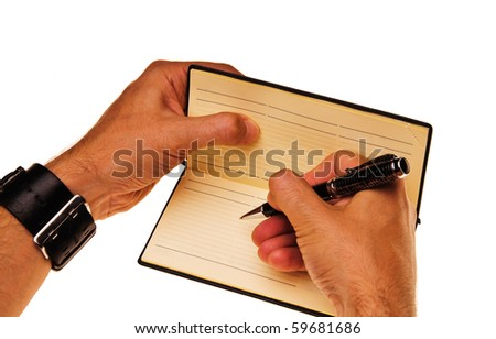 The man wrote in his notebook - stock photo