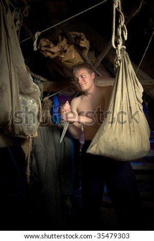 The maniac with a knife in the den - stock photo
