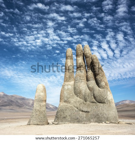 The Mano de Desierto is a large-scale sculpture of a hand located in the Atacama Desert in Chile - stock photo