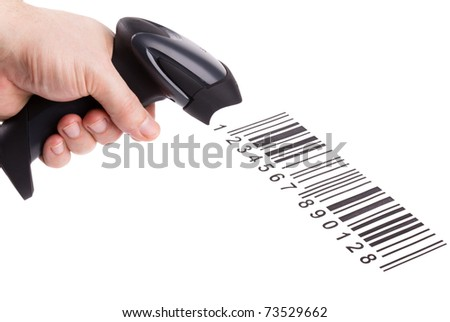 The manual scanner of bar codes in man hand - stock photo