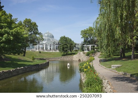 The Marjorie MacNeely Conservatory at Como Park in St. Paul Minnesota on a bright summer afternoon - stock photo