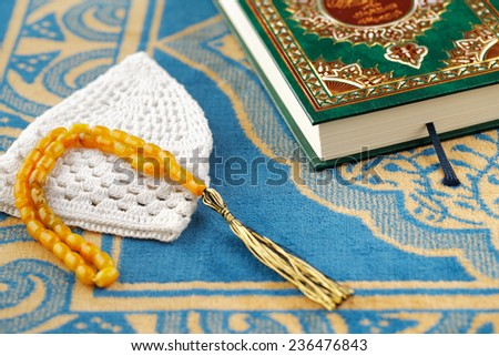 The Masbaha is also known as Tasbih is a string of prayer beads which is traditionally used by Muslims along with the Quran - stock photo