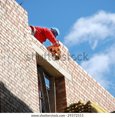 The mason behind work. House building. - stock photo