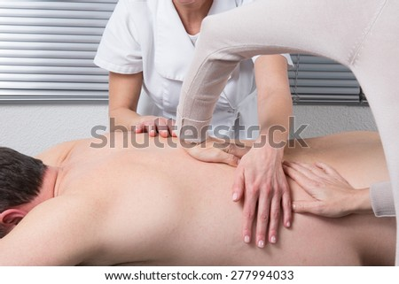 The massage with 4 hands - stock photo