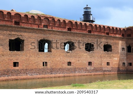 The massive but unfinished Fort Jefferson, on Florida's Garden Key, features a moat and a lighthouse. - stock photo