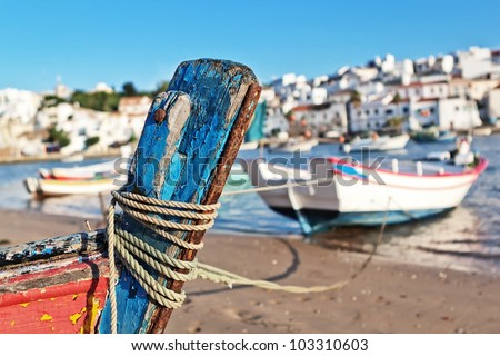 The mast of the old boat on the shore of Ferragudo. Seascape. - stock photo