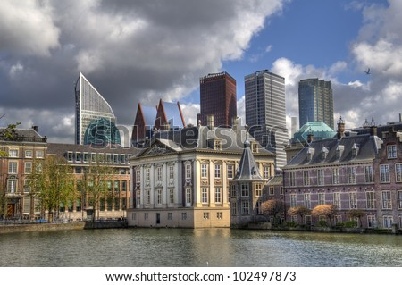 The Mauritshuis Museum at the Binnenhof, with modern office towers in the background, in The Hague, Holland - stock photo