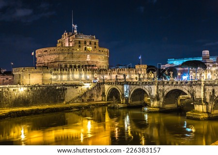 The Mausoleum of Hadrian, usually known as Castel Sant'Angelo and the Sant'Angelo bridge illuminated by night. Photo Rome, Italy - stock photo