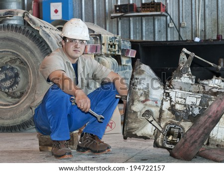 The mechanic has a rest on a workplace before repair - stock photo