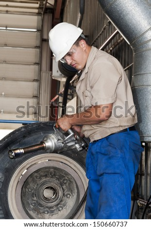 The mechanic prepares for equipment repair, it holds the tool. - stock photo