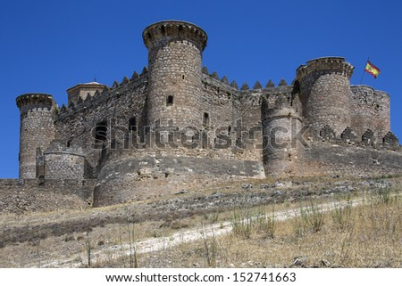 The medieval fortress in the town of Belmonte in the municipality of Cuenca in the La Mancha region of central Spain. - stock photo