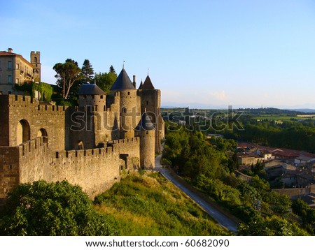 The medieval fortress of Caracassonne overlooking the countryside of southern France at sunset - stock photo